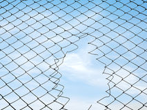 Mesh fence. Silhouette mesh fence. Hole in the fence royalty free stock photos