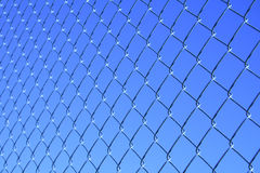 Mesh fence. On blue sky background Stock Photo