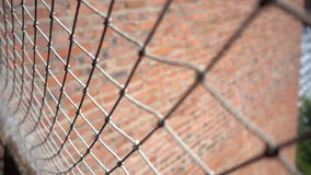 Mesh fence close up stock footage