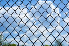 Mesh fence close up. Image with blurred background. Chain link fence Stock Photos
