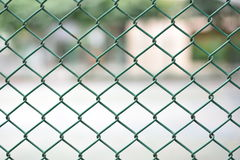 Mesh fence panel on blurred Background.  Stock Photography