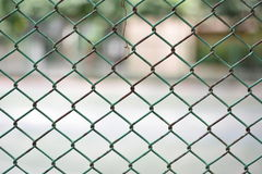 Mesh fence panel on blurred Background. Mesh fence panel on blurred Background Royalty Free Stock Photos