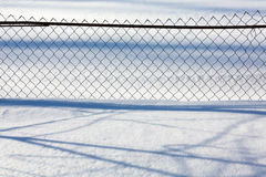 Mesh fence in winter Royalty Free Stock Photo