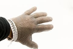 Mesh Gloves. Hand of a worker with a mesh glove anticut royalty free stock images