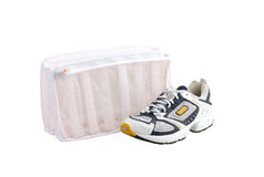Mesh laundry bag to fill sport shoe. For washing machine Royalty Free Stock Photography