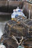 Mesh net shellfish traps at sea port Stock Image