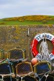 Mesh net shellfish traps at sea port Stock Photos