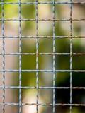 Mesh netting on the blur bokeh Royalty Free Stock Image