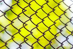 Mesh netting in perspective on a green background as a background royalty free stock photos