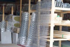 Mesh netting and reinforcement bars are for sale. stock photography
