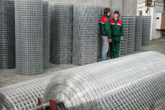 Mesh netting Warehouse. Leningrad, Russia - April 6, 2012: Plant for production of fences. Workshop packing wire mesh netting. Mesh netting in rolls Royalty Free Stock Photos