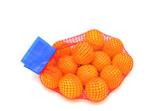 Mesh oranges from the supermarket Royalty Free Stock Images