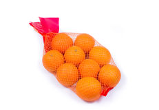 Mesh oranges from  supermarket. Isolated on white background Stock Photography