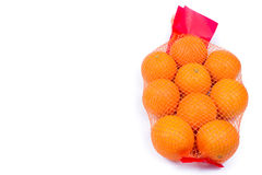 Mesh oranges from  supermarket. Isolated on white background Stock Image