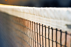 Mesh Tennis. Net (sports) - separates players of different teams (with some games in the ball Stock Photo