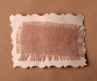 Mesh texture on brown kraft paper background Royalty Free Stock Images