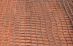 Mesh tool for cleaning clay tennis court Royalty Free Stock Images