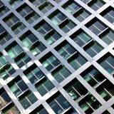 Mesh type of building with glass and metal detail Royalty Free Stock Photos