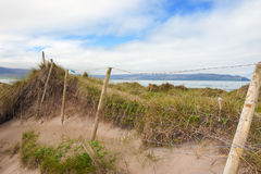 Mesh wire fence at the maharees Royalty Free Stock Photos