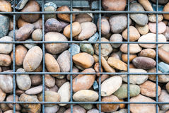 Meshed Metal and Rock Wall Background Stock Images