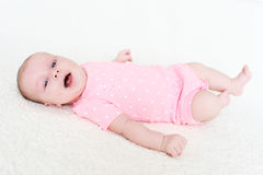 2 mesi felici sorridenti di neonata Fotografia Stock