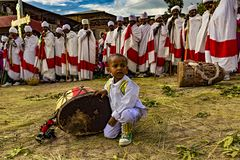 Meskel Celebration, Lalibela, Ethiopia. Ethiopia. Lalibela. The Meskel celebration, September 26th 2016. Priests in their ceremonial robes and child with ritual stock photography