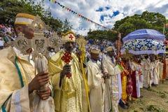 Meskel Celebration, Lalibela, Ethiopia. Ethiopia. Lalibela. The Meskel celebration, September 26th 2016. Priests in their ceremonial robes hold ornamental stock images