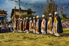 Meskel Celebration, Lalibela, Ethiopia. Ethiopia. Lalibela. The Meskel celebration, September 26th 2016. Priests in their ceremonial robes perform rhytmic dance stock image