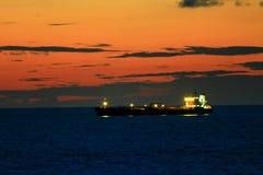 Orange sky. Mesmerising sunset with ships in background Stock Images