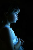 Mesmerized. A young girl standing in front of a window royalty free stock image