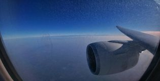 Mesmerizing Azure. View of the early morning sky/horizon from the plane Stock Images