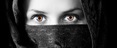 Mesmerizing beautiful eyes. Beautiful mesmerizing natural eyes.  Arabic Burka Stock Images