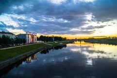 Mesmerizing blazing sunset over the Volga river. City of Tver, Russia. Boundless expanse. Mesmerizing blazing sunset over the mirror glossy surface of the Volga Stock Photo