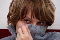 Mesmerizing eyes. A girl hiding her face behind a pullover stock photos