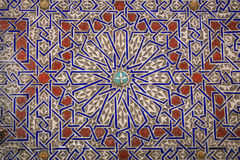 Azulejo Moroccan/Arabic Designs in Clay. This repetitive, mesmerizing, colorful, attractive azulejo tile Middle-eastern star design, painted and carved in clay Stock Images