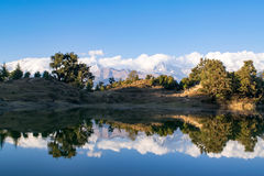 Mesmerizing reflection of Garhwal Himalayas in  Deoria Tal or Lake. Stock Image
