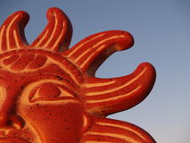 Meso-American Sun God. Mezo-American sun god clay pottery against a twilight sky royalty free stock image