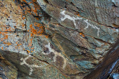 Mesolithic Petroglyphs carved in rocks Royalty Free Stock Images