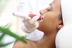 Mesotherapy microneedle, the woman at the beautician Stock Image