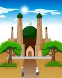 Happy cartoon Muslim kids waving hand in front of mosque royalty free illustration