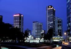 Mesquita de Jamek e skyline, Kuala Lumpur, Malásia Imagem de Stock