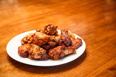 Mesquite Barbecued Wings on Wood Table Stock Image
