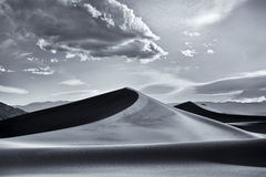 Mesquite Dunes, Death Valley National Park. The stark light of late afternoon accentuates the strong curves and shadow lines of the fantastic Mesquite Dunes in Stock Photography