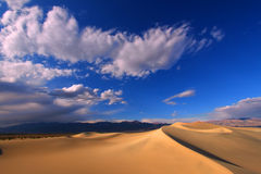 Mesquite Flat Sand Dunes. Dark blue skies over the Mesquite Flat Sand Dunes of Death Valley National Park Stock Photo