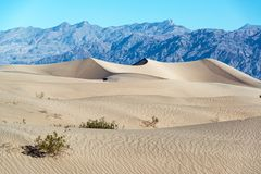 Sand Dunes and Mountains Stock Photo