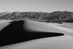 Mesquite Sand Dunes - Death Valley. Mesquite Sand Dunes in the Death Valley National Park in the early morning with beautiful shadows of the ripples Stock Images