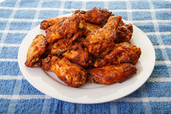 Mesquite Wings on Blue Placemat Royalty Free Stock Image