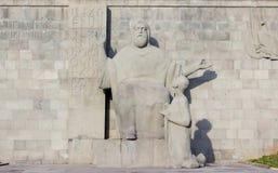 The Mesrop Mashtots statue in Yerevan , Armenia. The Mesrop Mashtots Institute of Ancient Manuscripts royalty free stock photo