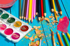 Mess in the the artist's studio, watercolor paints and colored pencils. royalty free stock photos
