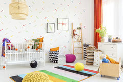 Mess in a baby room. Mess in a modern white baby room in scandinavian style Royalty Free Stock Images